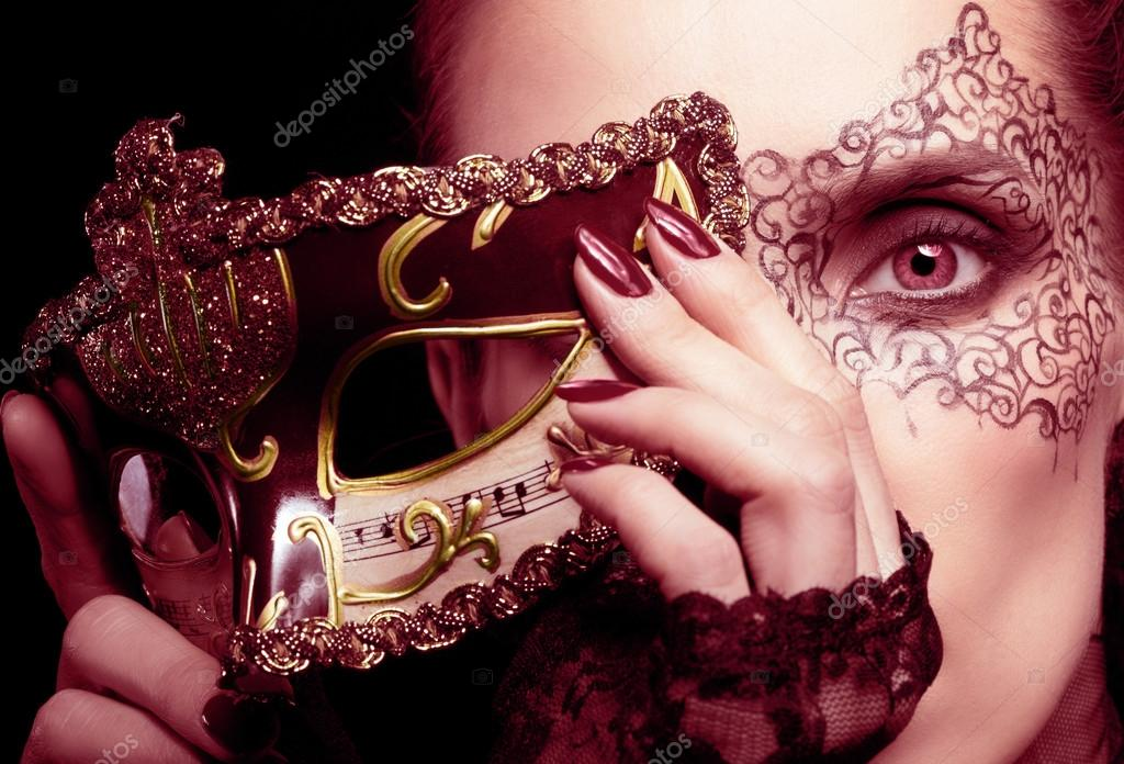 Gorgeous woman with mask in marsala colors