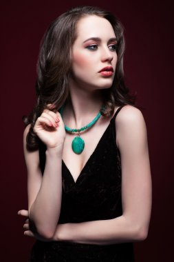 Young beautiful woman in black dress with green pistachio colour
