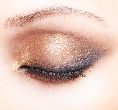 Close-up shot of female closed eye make-up