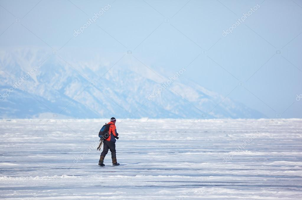 Nature photographer traveling on Baikal Lake in Siberia at winte