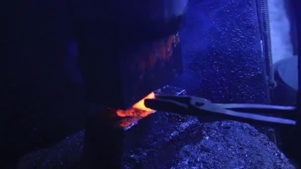 Smith hammering piece of iron