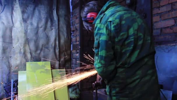 Smith grinding piece of iron