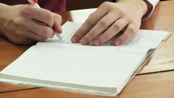 Pen writes in a notebook