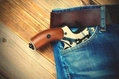 silver revolver in the pocket