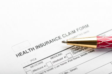 Pen on insurance claim form
