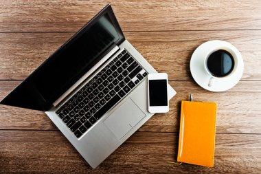 Laptop, smartphone coffee in office