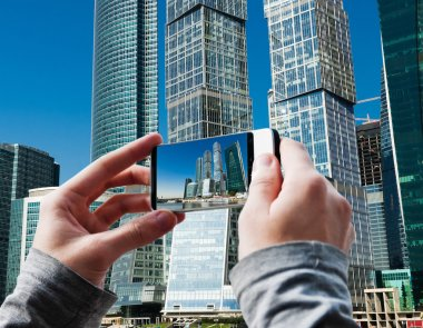 Tourist taking a picture of Moscow City buildings
