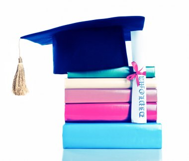 A mortarboard and graduation scroll on books