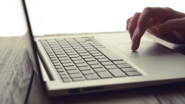 Woman Scrolls a Website