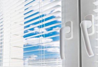 Window with white jalousie