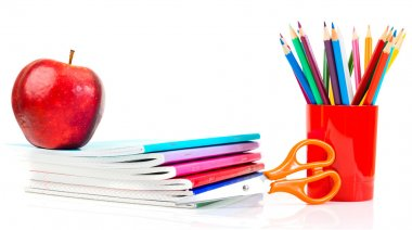 notebooks, pencils and apple