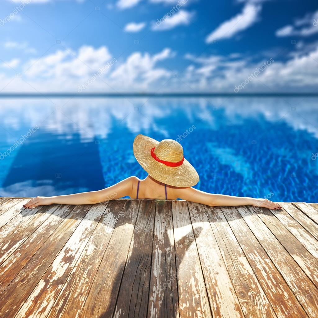 Woman in hat at poolside