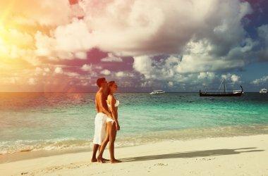 Couple on beach at Maldives
