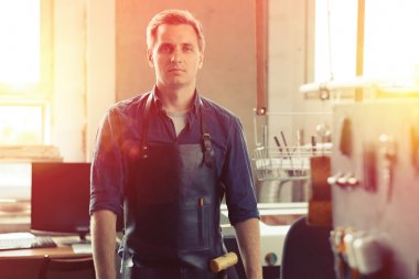 handsome leather workshop owner