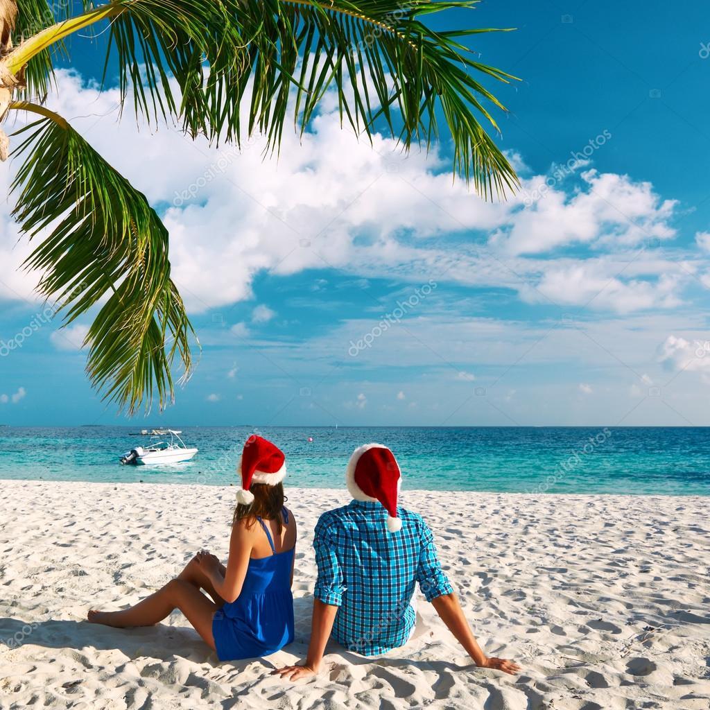 Couple on beach at christmas