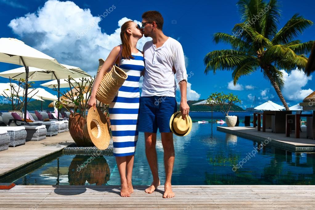 Couple kissing near poolside