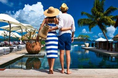 Couple near poolside jetty