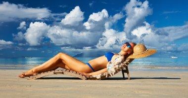 Woman in bikini on tropical beach