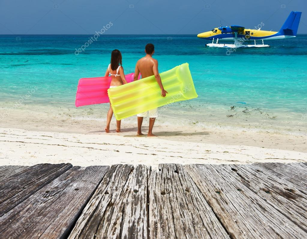 Couple with inflatable rafts l