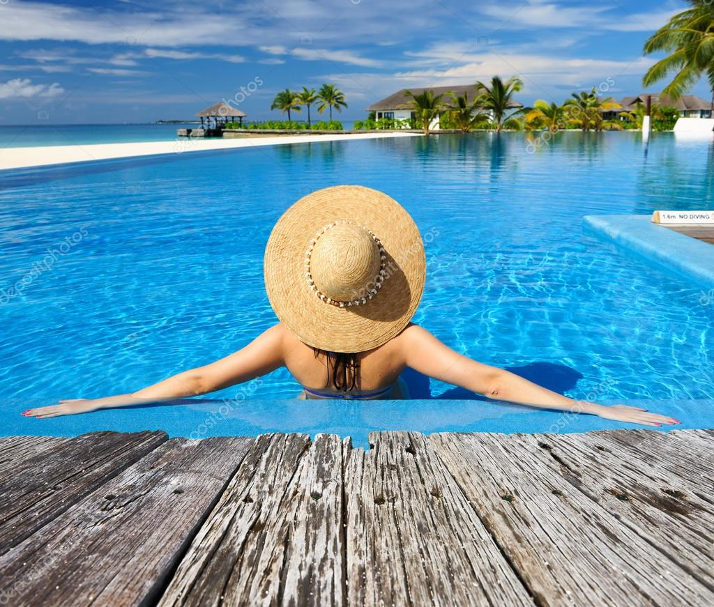 Woman relaxing at poolside