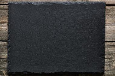Slate on wooden  background