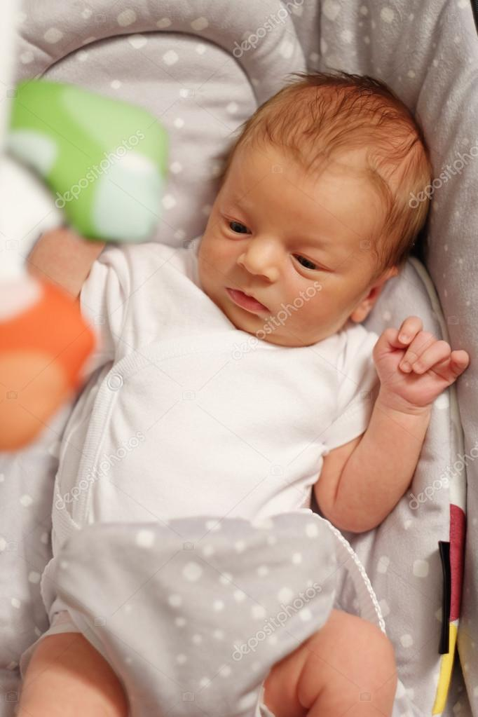 Two weeks old newborn baby stock photo