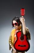 Muž s kytarou v hudební pojetí