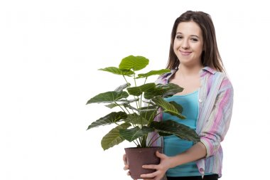 Young woman taking care of plants isolated on white