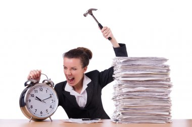 Woman desperate with time hitting clock with hammer
