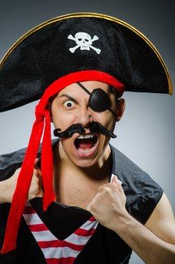 Funny pirate in the dark studio