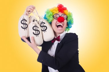Businessman clown with money bags