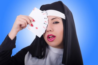 Nun playing cards
