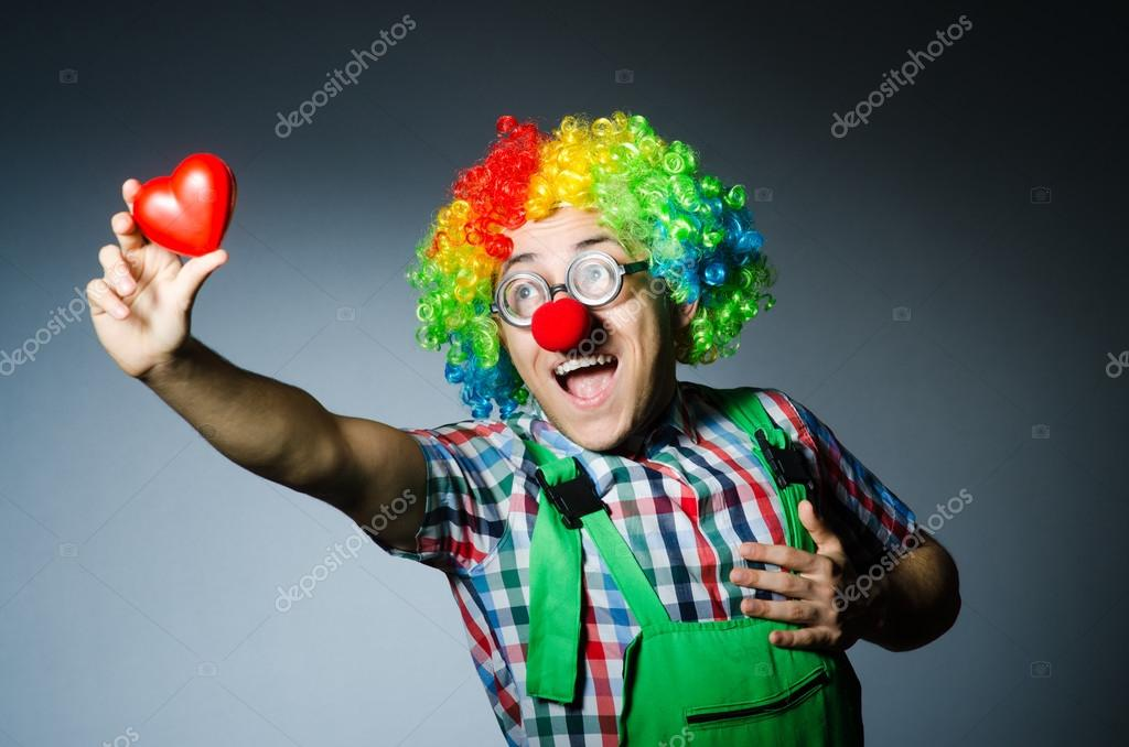 Clown with red heart in romantic concept