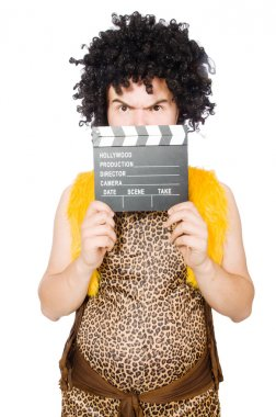 Cave man with movie board isolated on white