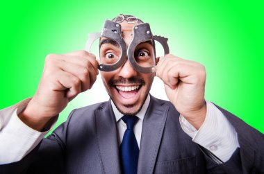 Funny businessman with handcuffs