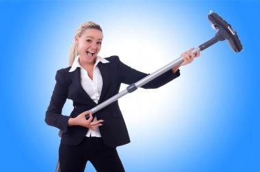 Businesswoman with vacuum cleaner