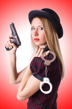Woman with gun and money