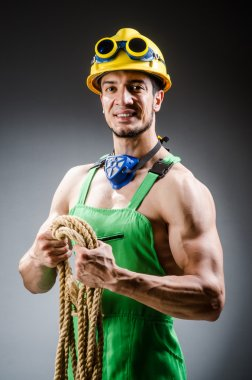 Ripped builder man with tools
