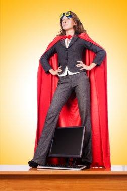 Businesswoman in super woman