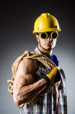 Muscular builder man with tools