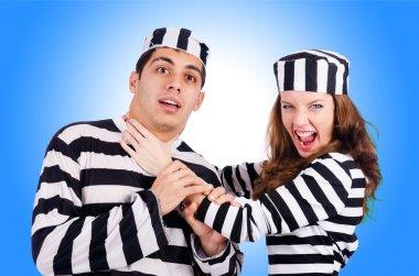 Pair of prisoners  on blue