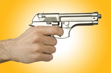 Silver Gun in the hand on yellow stock vector