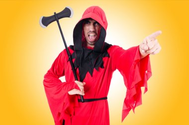 Executioner in red costume with axe