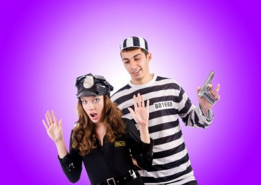 Police lady and prison inmate against the gradient