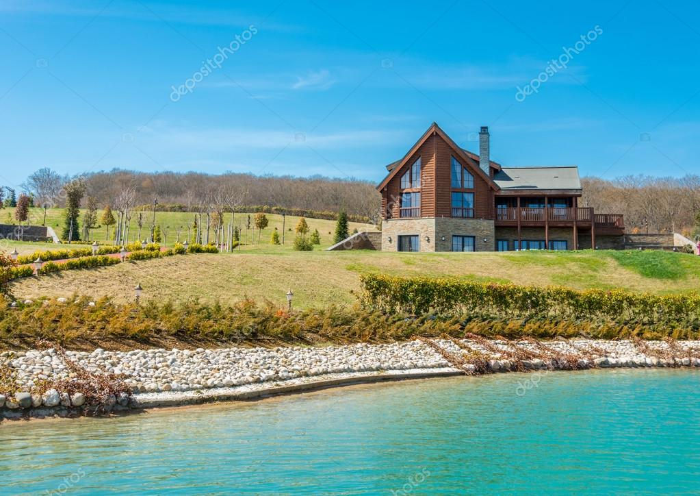 Modern house near water on bright day