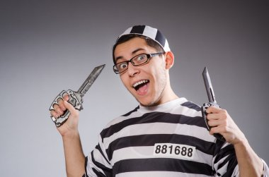 Funny prisoner with knuckles isolated on gray