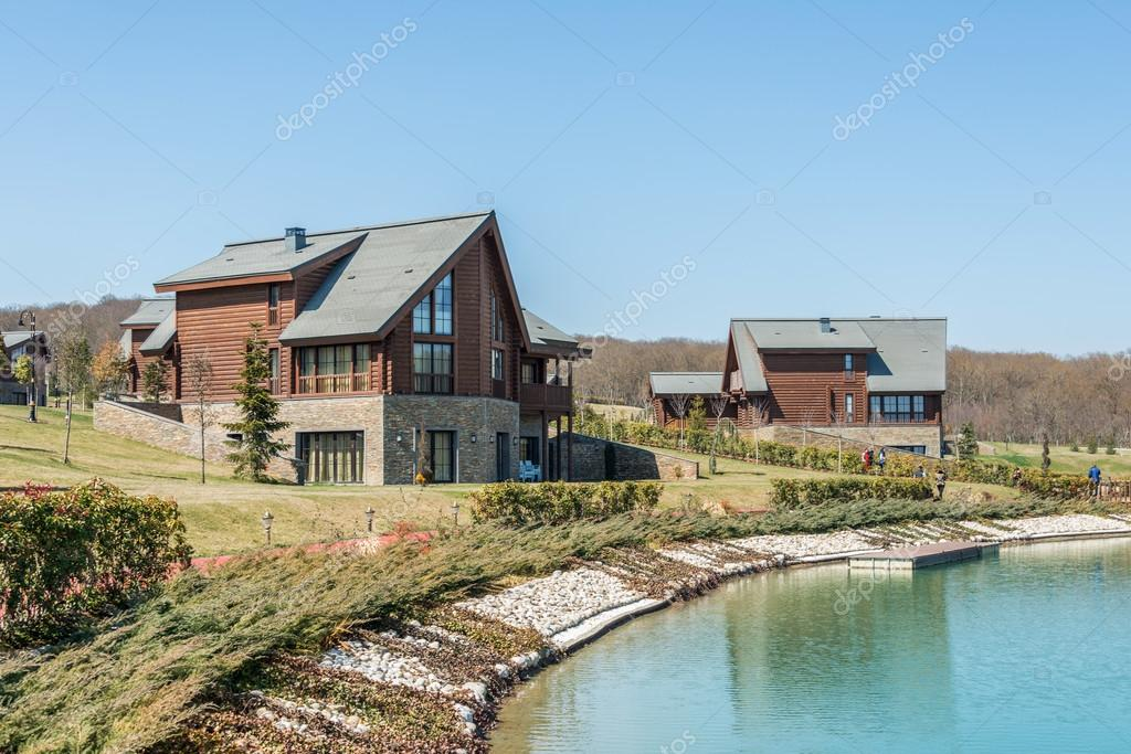 Modern houses near water on bright day