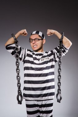 Young prisoner in chains