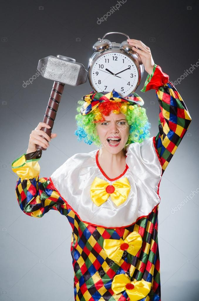Clown with hammer and clock