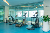 Fotografie Modern gym with various sports equipment